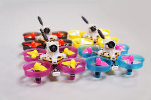 Four AcroBee micro drones showing different color options