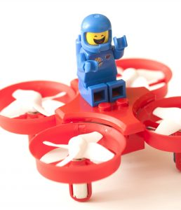 Benny from the LEGO movie rides the Eachine 011C