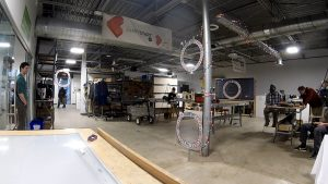 Race gates attached to poles and set on tables at a maker space